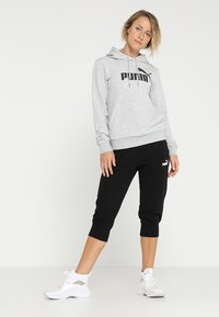 Puma - ESS CAPRI PANTS  - 3/4 sportsbukser - cotton black - 1