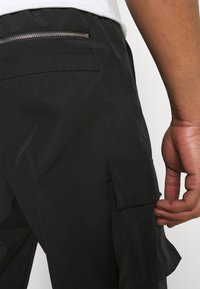 Mennace - TRACKSUIT BOTTOM - Tracksuit bottoms - black - 4