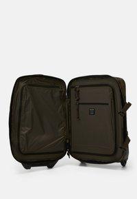 Filson - DRYDEN 2 WHEELED CARRY ON BAG - Wheeled suitcase - mottled olive - 4