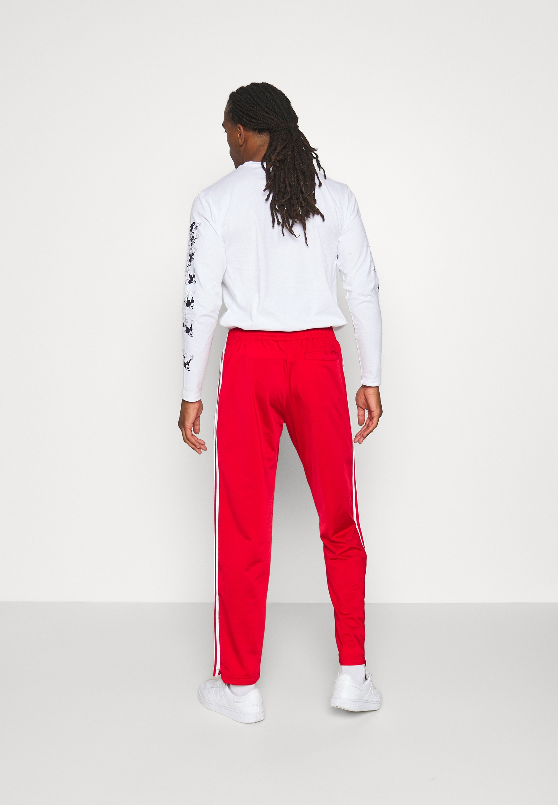 adidas Originals Tracksuit bottoms - scarle/white HHSSn