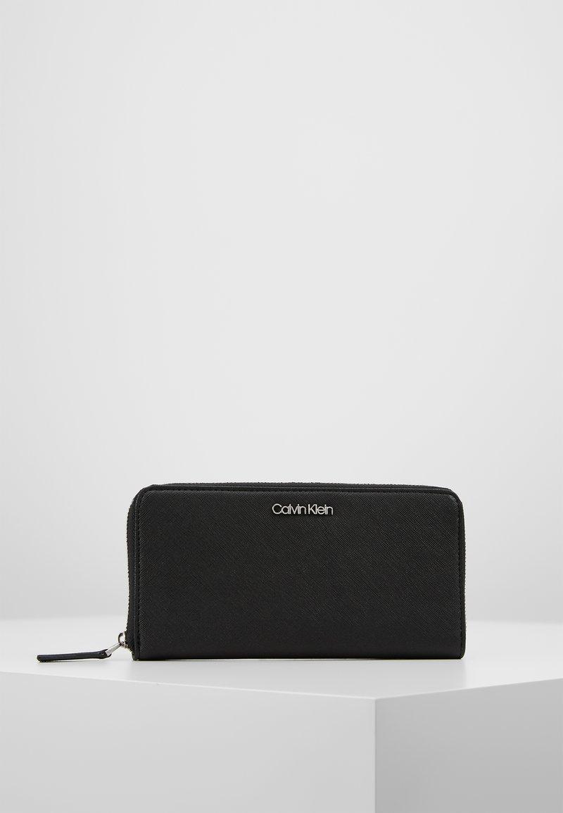 Calvin Klein - TASK ZIPAROUND - Peněženka - black