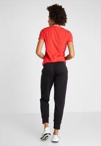 Calvin Klein Performance - PANTS - Verryttelyhousut - black - 2