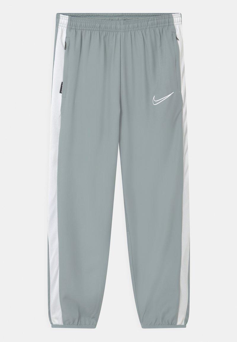 Nike Performance - DRY UNISEX - Pantalones deportivos - light pumice/white