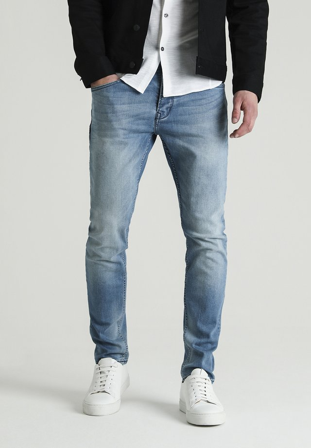 CROWN BARKIS - Straight leg jeans - blue