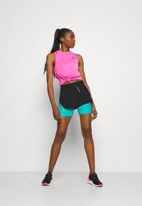 Puma - TRAIN FIRST MILE XTREME - Pantalón corto de deporte - black/viridian green - 1