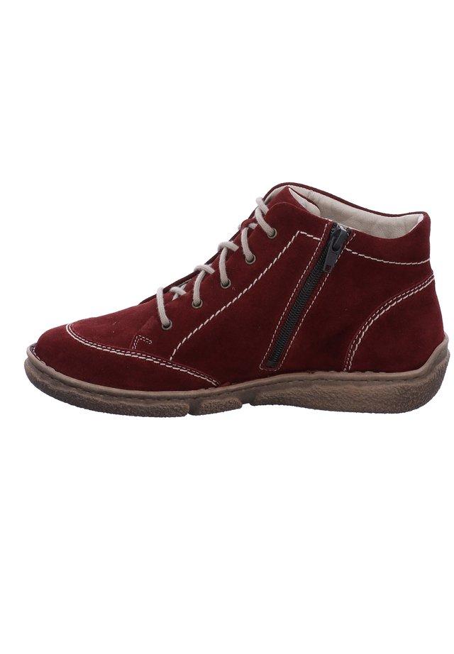 NEELE  - Lace-up ankle boots - carmin