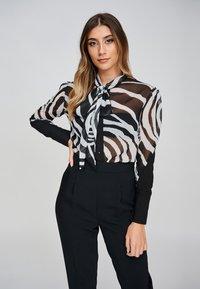 Yan Neo London - Button-down blouse - black - 0