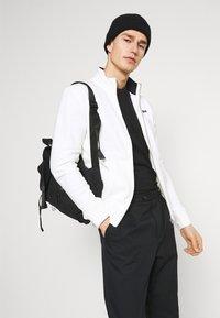 Schott - Zip-up sweatshirt - off white - 3
