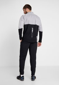 Nike Performance - RUN STRIPE PANT - Tracksuit bottoms - black/silver - 2
