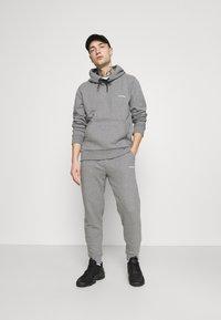 Calvin Klein - SMALL LOGO - Tracksuit bottoms - grey - 1