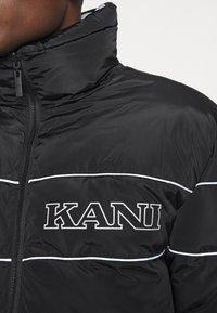 Karl Kani - RETRO REVERSIBLE PUFFER JACKET - Winter jacket - black - 6