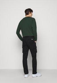forét - DUST CARGO  - Cargo trousers - black - 2