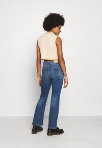 JDY - JDYNEWFLORA NEELA LIFE HGH FLARE  - Straight leg jeans - medium blue denim - 2