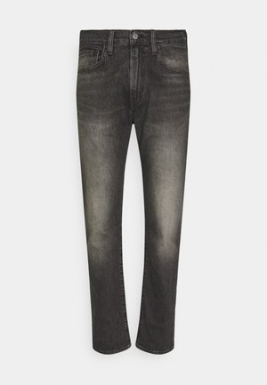 502 TAPER - Slim fit jeans - blacks