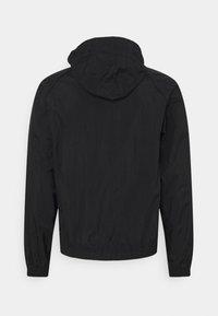 Nike Sportswear - TRACK - Kevyt takki - black/white - 1