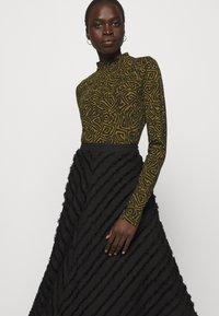 Proenza Schouler White Label - FRINGE FIL COUPE SKIRT - A-line skirt - black - 4