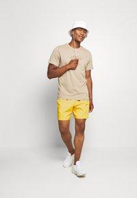 Nike Sportswear - FLOW - Shorts - opti yellow/white - 1