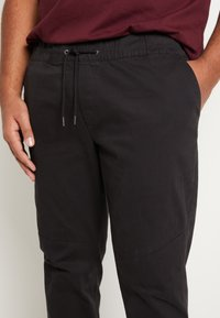 Jack & Jones - JJIVEGA JJJOGGER - Trousers - black - 6