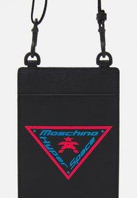 MOSCHINO - UNISEX - Across body bag - black - 4