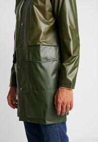 Rains - UNISEX HOODED COAT - Impermeable - foggy green - 4