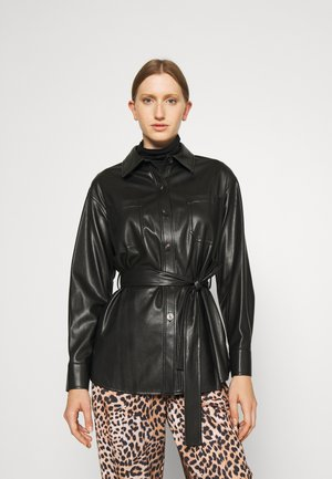 AMITASA - Halflange jas - black
