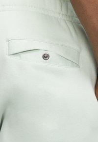 Nike Sportswear - CLUB - Tracksuit bottoms - pistachio frost/pistachio frost/white - 6