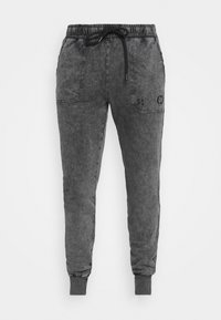 ESSENTIAL DISTRESSED - Tracksuit bottoms - washed black