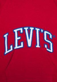 Levi's® - Mikina skapucí - red - 2
