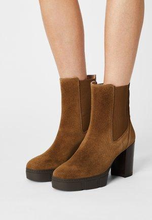 KUBEL - Platform ankle boots - tanger
