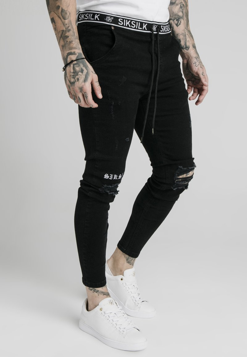 SIKSILK - ELASTICATED WAIST DISTRESSED - Vaqueros pitillo - black