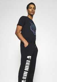 Blood Brother - HANOVER PARK UNISEX - Tracksuit bottoms - black - 3