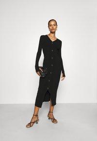 HUGO - SAFFAT - Jumper dress - black - 1
