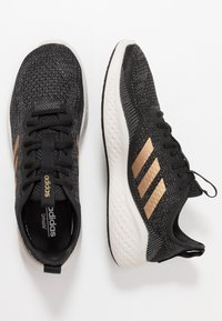 adidas Performance - FLUIDFLOW - Neutral running shoes - core black/tactile gold metallic/grey six - 1