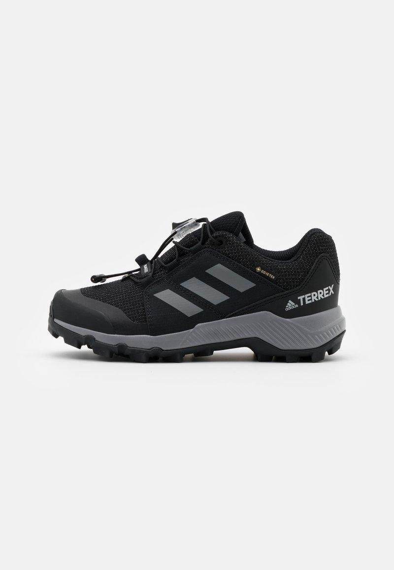 adidas Performance - TERREX GTX UNISEX - Hiking shoes - core black/grey three