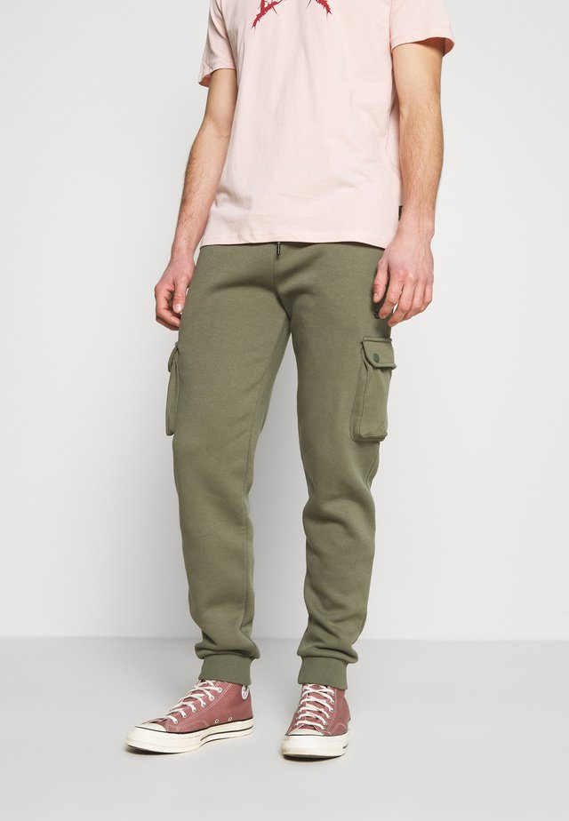 COMBAT - Trainingsbroek - khaki