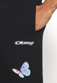 Obey Clothing - KYOTO - Tracksuit bottoms - black - 5