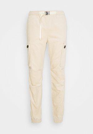 CORDUROY CARGO - Cargo trousers - beige