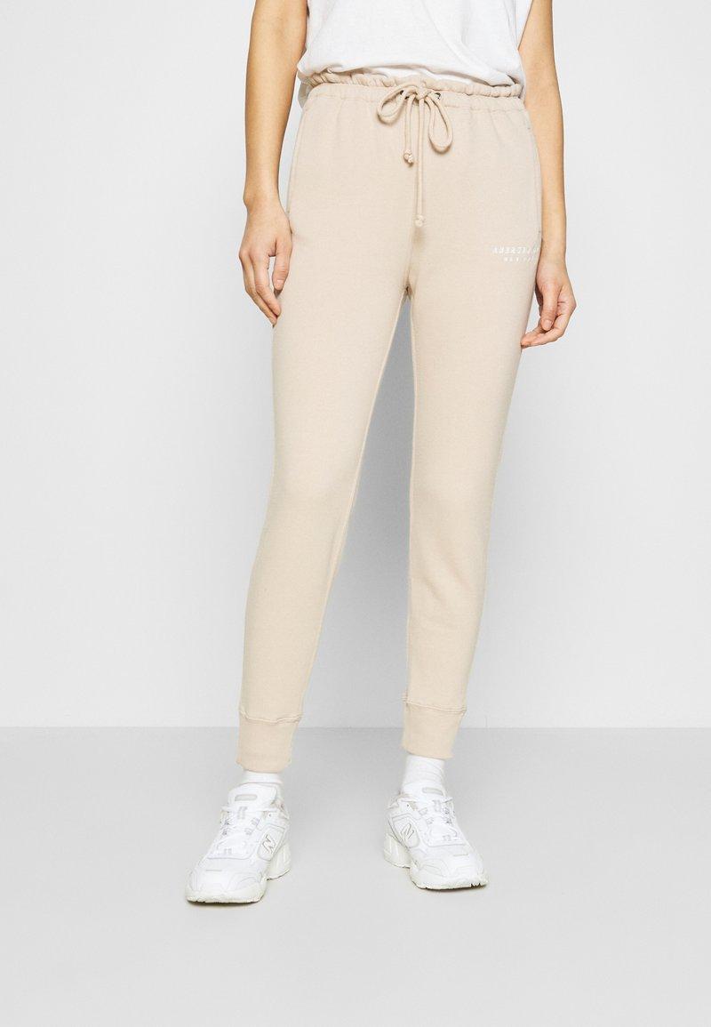 Abercrombie & Fitch - TREND LOGO WAISTED  - Teplákové kalhoty - beige