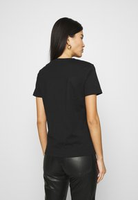 Guess - T-shirt imprimé - jet black - 2
