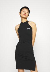 Puma - BODYCON DRESS - Shift dress - black - 0
