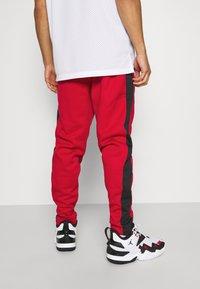 Jordan - AIR THERMA PANT - Teplákové kalhoty - gym red/black - 2