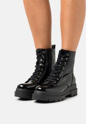 VEGAN XENIA - Platform ankle boots - black