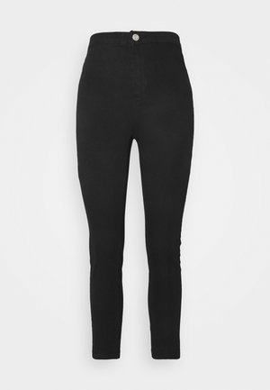 OUTLAW - Trousers - black