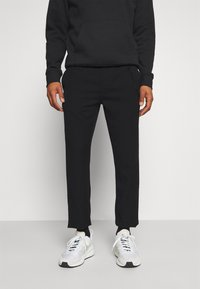 Tommy Jeans - SOLID SCANTON PANT - Trousers - black - 0