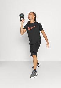 Nike Performance - DRY - T-shirt con stampa - black - 1