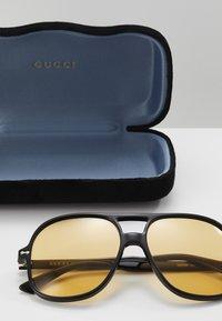 Gucci - Solbriller - black/yellow - 3