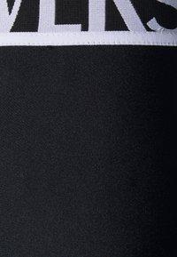 Versace Jeans Couture - PANTS - Leggings - Trousers - black - 10