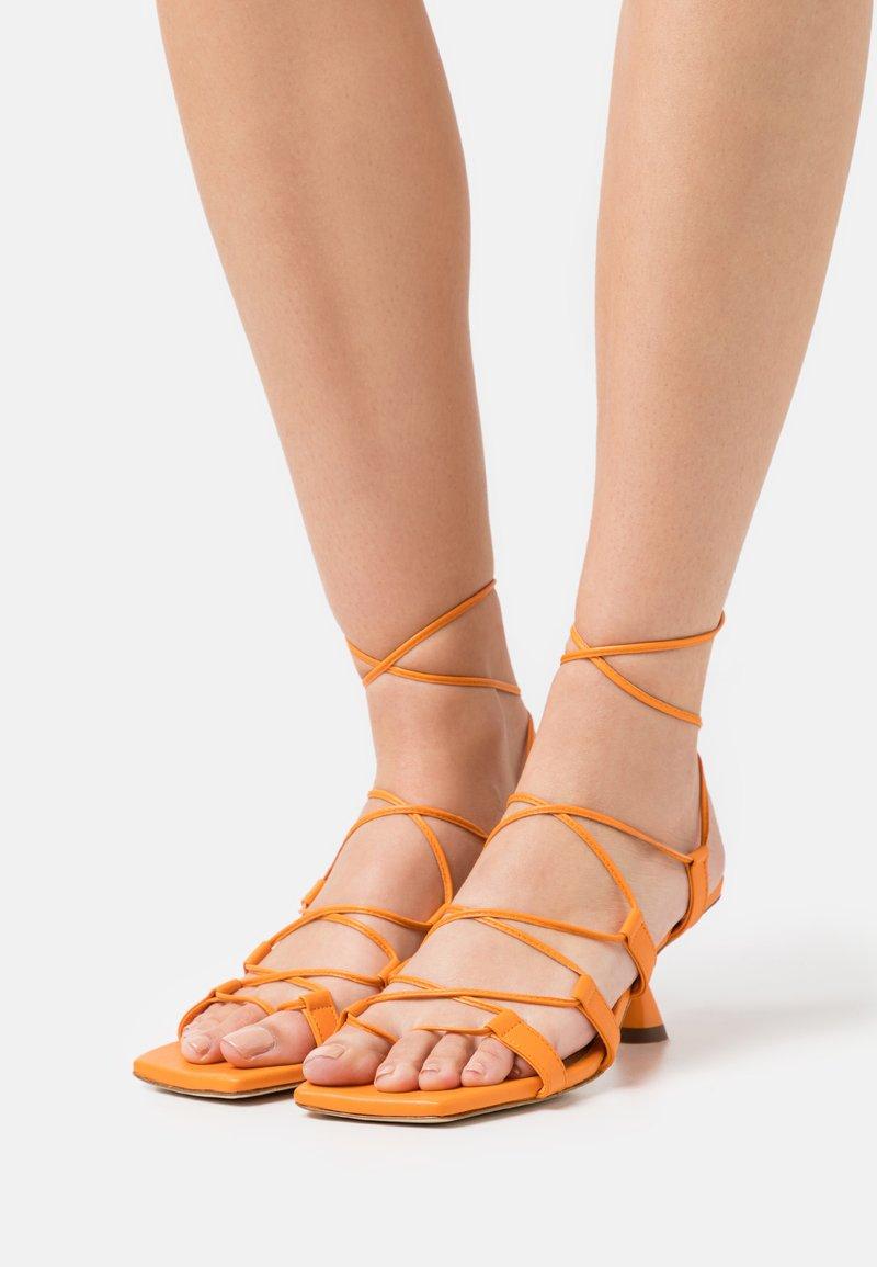 Rejina Pyo - MALIA - T-bar sandals - orange
