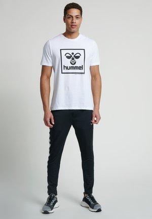 TAPERED - Club wear - black