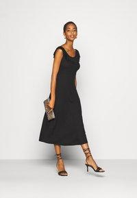 ONLY Tall - ONLFIESTA DRESS - Žerzejové šaty - black - 1